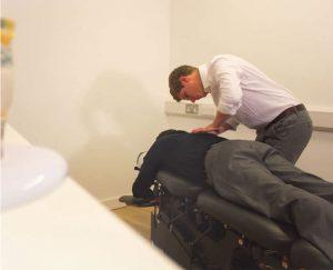 Man receiving chiropractic treatment