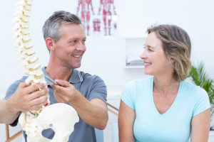 chiropractor in London consulting with a patient